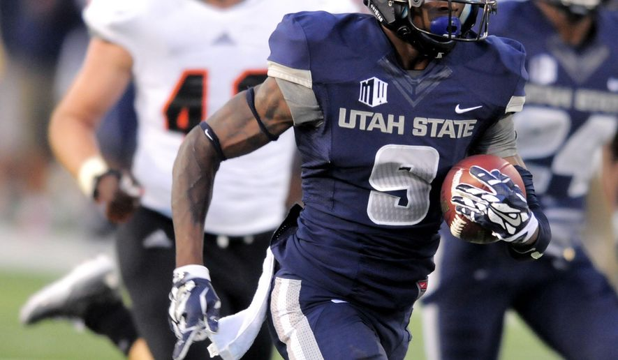 Utah State wide receiver JoJo Natson (9) returns a punt 52 yards for a touchdown against Idaho State, during an NCAA college football game, Saturday Sept. 6, 2014, in Logan, Utah. (AP Photo/The Herald Journal, Eli Lucero)