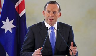 Australian Prime Minister Tony Abbott speaks during a joint press conference with his Malaysian counterpart Najib Razak after a meeting in Putrajaya, Malaysia, in this Sept. 6, 2014, file photo. The Australian government on Friday, Sept. 12, 2014, elevated its terrorism threat level to the second-highest warning in response to the domestic threat posed by Islamic State movement supporters. (AP Photo/Lai Seng Sin, File)