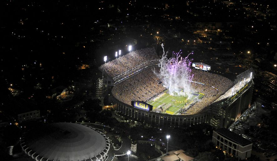 In this Nov. 3, 2012 photo provided by LSU, fireworks are seen from pre-game festivities in Tiger Stadium, before the start of an NCAA college football game between LSU and Alabama in Baton Rouge, La. On Saturday nights in the fall, night games when Tiger Stadium is most rowdy and raucous, there is no louder football stadium in America. (AP Photo/LSU, Hilary Scheinuk, File)