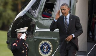 President Barack Obama salutes as he arrives on the South Lawn of the White House, on Friday, Sept. 12, 2014, in Washington. Obama traveled to the Fort McHenry historic site that is celebrating the 200th anniversary of the Battle of Baltimore, and also attended a private Democratic fundraiser. (AP Photo/Evan Vucci)