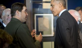 President Barack Obama listens to Vincent Vaise, National Parks Service Ranger and Chief of Interpretation at Fort McHenry, left, talk about the original manuscript of the 'Star Spangled Banner' during his tour of Fort McHenry Visitor and Education Center in Baltimore, Friday, Sept. 12, 2014. Also joining the tour with Obama are Sen. Ben Cardin, D-Md., left, and Burt Kummerow, right, CEO of Maryland Historical Society. Obama traveled to the historic site that is celebrating the 200th anniversary of the Battle of Baltimore and will also attend a private Democratic fundraiser before returning to Washington. (AP Photo/Pablo Martinez Monsivais)