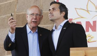 "FILE - In this Saturday, Sept. 6, 2014 file photo, Sen. Pat Roberts, left, R-Dodge City, and Greg Orman, Independent for U.S. Senate, speak at the conclusion of their Senatorial Debate at the Kansas State Fair in Hutchinson, Kan. On Friday, Sept. 12, 2014, Roberts posted an online ad attacking independent candidate Orman as a liberal pretending to be a Kansas conservative and immediately faced demands from the challenger to remove the spot over ""manipulated"" audio from a recent debate. (AP Photo/The Hutchinson News, Lindsey Bauman)"