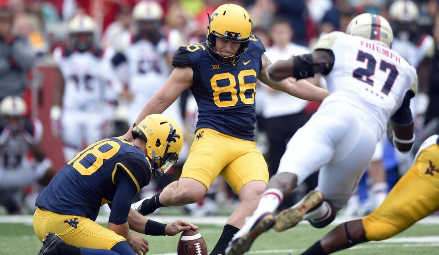 West Virginia place kicker Josh Lambert (86) kicks the game-winning field goal during an NCAA college football game against Maryland, Saturday, Sept. 13, 2014, in College Park, Md. West Virginia won 40-37. (AP Photo/Nick Wass)