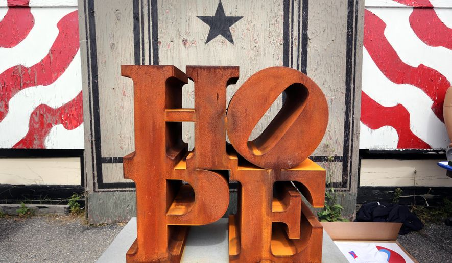 """A steel version of Robert Indiana's HOPE sculpture is displayed outside his home on the first annual """"International HOPE Day his 86th birthday, Saturday, Sept. 13, 2014, on Vinalhaven Island, Maine. (AP Photo/Robert F. Bukaty)"""