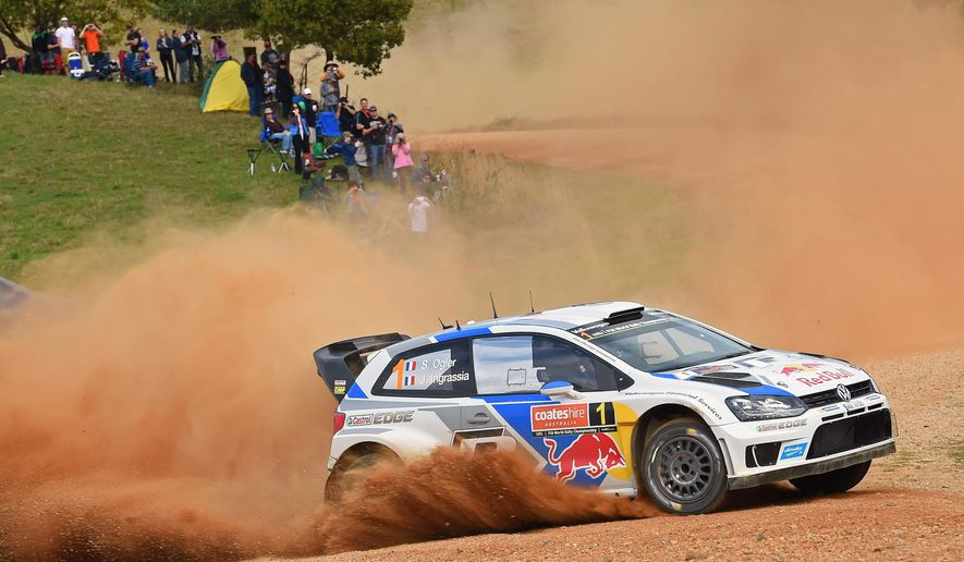 In this photo provided by Rally Australia, Sebastien Ogier and co-driver Julien Ingrassia, both from France, race their car during the Australian leg of the World Rally Championship new Coffs Harbour, Saturday, Sept. 13, 2014. (AP Photo/Rally Australia) EDITORIAL USE ONLY