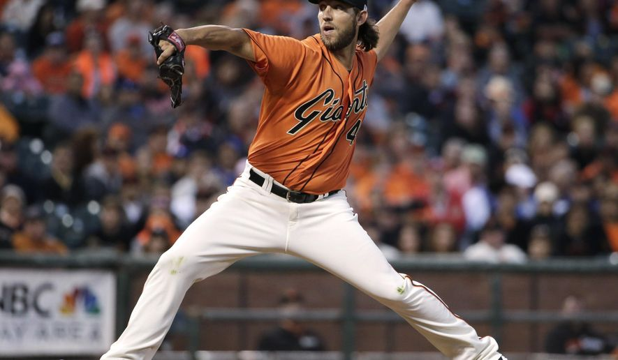 San Francisco Giants starting pitcher Madison Bumgarner throws to the Los Angeles Dodgers during the first inning of a baseball game Friday, Sept. 12, 2014, in San Francisco. (AP Photo/Marcio Jose Sanchez)