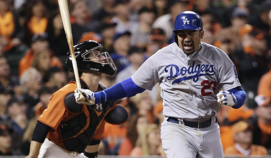 Los Angeles Dodgers' Adrian Gonzalez reacts after striking out during the fifth inning of a baseball game against the San Francisco Giants on Friday, Sept. 12, 2014, in San Francisco. (AP Photo/Marcio Jose Sanchez)