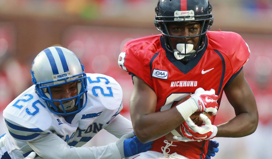 Richmond Spiders' Rashad Ponder (8) rushes against Hampton Pirates'Marcus Wade (25) after receiving 17-yard pass in the first half of the football game at University of Richmond, Va., Saturday, Sept. 13, 2014, in Richmond, Va.  (AP Photo/Richmond Times-Dispatch, Daniel Sangjib Min)