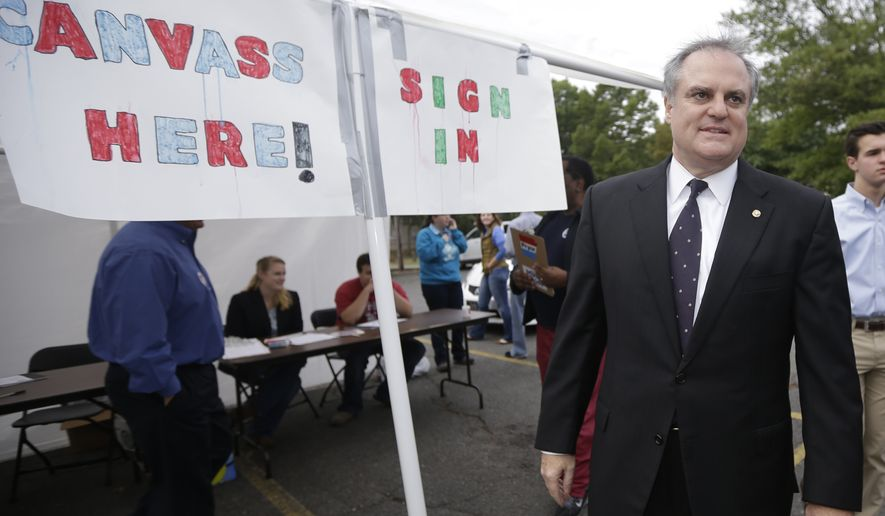 U.S. Sen. Mark Pryor, D-Ark., arrives at a rally for campaign volunteers Saturday, Sept. 13, 2014, in Little Rock, Ark. Pryor will face Republican challenger U.S. Rep. Tom Cotton in the November election. (AP Photo/Danny Johnston)
