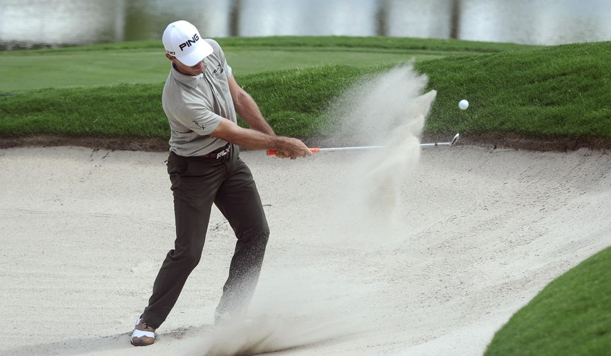Billy Horschel hits out of a bunker to the 18th green during the second round of the Tour Championship golf tournament, Friday, Sept. 12, 2014, in Atlanta. Horschel finished the day in the lead. (AP Photo/John Amis)