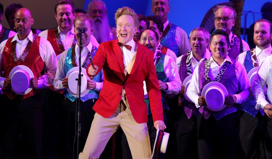 "In this photo provided by the Hollywood Bowl, Conan O'Brien performs ""The Monorail Song"" at the world premiere of ""The Simpsons Take the Bowl"" at the legendary concert venue Friday, Sept. 12, 2014, in Los Angeles. The program featured music, stars and reminiscences from TV's longest-running scripted show. (AP Photo/The Hollywood Bowl, Greg Grudt)"