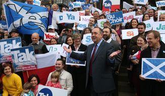 "In this photo taken on Tuesday, Sept. 9, 2014, Scottish First Minister Alex Salmond meets with Scots and other European citizens to celebrate European citizenship and ""Scotland's continued EU membership with a Yes vote"" at  Parliament Square in Edinburgh. (AP Photo/PA, Andrew Milligan) UNITED KINGDOM OUT, NO SALES, NO ARCHIVE"