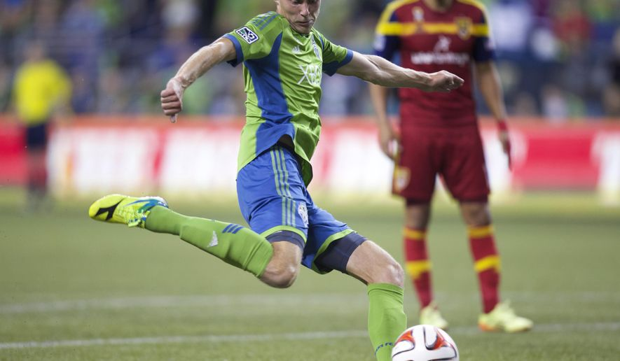 Seattle Sounders' Andy Rose scores in stoppage time against Real Salt Lake during the second half of an MLS soccer match, Friday, Sept 12, 2014, in Seattle. Seattle won 3-2. (AP Photo/Stephen Brashear)