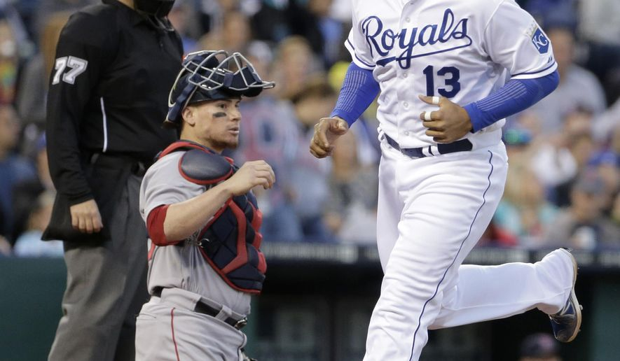 Kansas City Royals' Salvador Perez runs past Boston Red Sox catcher Christian Vazquez to score on a balk by starting pitcher Rubby De La Rosa during the fourth inning of a baseball game Saturday, Sept. 13, 2014, in Kansas City, Mo. (AP Photo/Charlie Riedel)