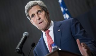 """U.S. Secretary of State John Kerry speaks during a joint press conference with Egyptian Foreign Minister Sameh Shukri in Cairo, Egypt, on Saturday, Sept. 13, 2014. Kerry described Egypt as an """"important partner"""" during a short stop in Cairo to shore up support for President Barack Obama's initiative to assemble a coalition of nations to go after the Islamic State group, which holds large parts of Iraq and Syria. (AP Photo/Brendan Smialowski, Pool)"""