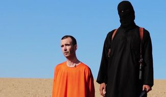 EDS NOTE: GRAPHIC CONTENT - This image made from video posted on the Internet by Islamic State militants and provided by the SITE Intelligence Group, a U.S. terrorism watchdog, on Saturday, Sept. 13, 2014, purports to show British aid worker David Haines before he was beheaded. The video emerged hours after the family of Haines issued a public plea on Saturday urging his captors to contact them. The 44-year-old Haines was abducted in Syria in 2013 while working for an international aid agency. (AP Photo)