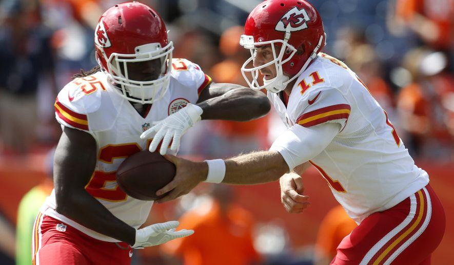 Kansas City Chiefs quarterback Alex Smith (11) and Jamaal Charles (25) warm up prior to an NFL football game against the Denver Broncos, Sunday, Sept. 14, 2014, in Denver. (AP Photo/Joe Mahoney)
