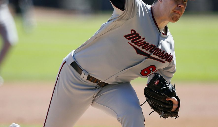 Minnesota Twins starting pitcher Trevor May delivers against the Chicago White Sox during the first inning of a baseball game Sunday, Sept. 14, 2014, in Chicago. (AP Photo/Andrew A. Nelles)