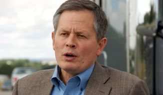 This Monday, Aug. 25, 2014, file photo U.S. Rep. Steve Daines, a first-term Montana Republican seeking election to the U.S. Senate, talks to media in Billings. (AP Photo/Matthew Brown) ** FILE **