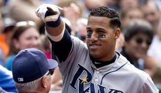 Tampa Bay Rays Yunel Escobar taunts fans after hitting a solo home run during the eighth inning against the Toronto Blue Jays in a baseball game Sunday, Sept. 14, 2014, in Toronto. (AP Photo/The Canadian Press, Frank Gunn)