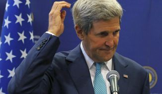 In this Friday, Sept. 12, 2014 photo, U.S. Secretary of State John Kerry reacts as he listens to his Turkish counterpart Mevlut Cavusoglu in Ankara, Turkey. Kerry is in Ankara to press Turkey to join an international coalition against the Islamic State. (AP Photo/Burhan Ozbilici)