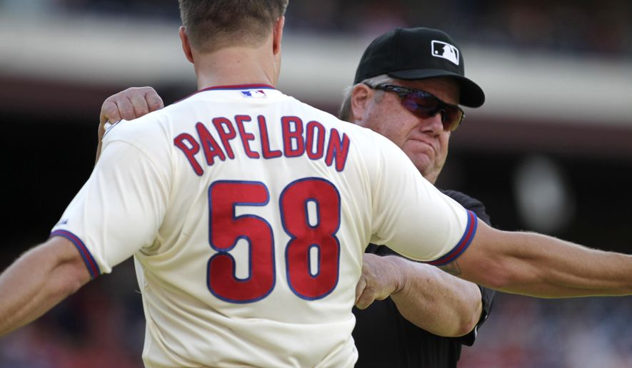 Philadelphia Phillies pitcher Jonathan Papelbon argues with Umpire Joe West after being ejected from the game against the Miami Marlins in the ninth inning of a baseball game Sunday, Sept. 14, 2014, in Philadelphia. The Marlins won 5-4. (AP Photo/H. Rumph Jr)