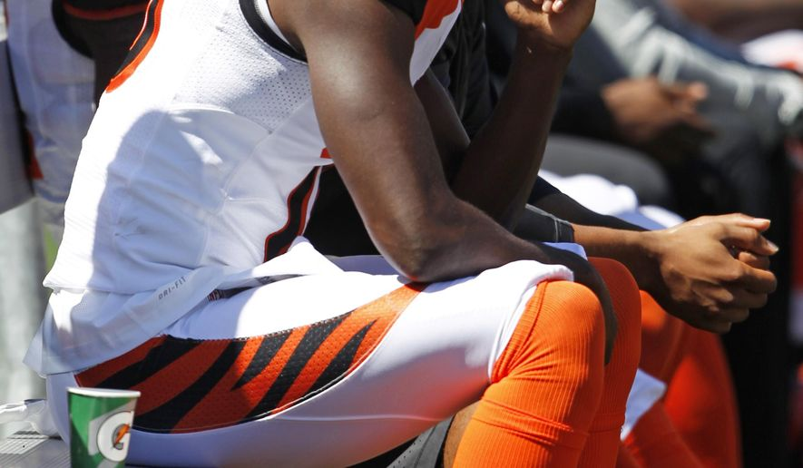 Cincinnati Bengals wide receiver A.J. Green sits on the bench with an injury in the first half of an NFL football game against the Atlanta Falcons, Sunday, Sept. 14, 2014, in Cincinnati. (AP Photo/Frank Victores)