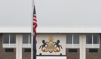 The U.S. flag is flow at half-staff outside of the Pennsylvania State Police headquarters in Dunmore, Pennsylvania, on after a late-night ambush outside a state police barracks in left one trooper dead and another critically wounded. (AP Photo/ The Times-Tribune,  Jake Danna Stevens)