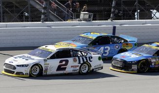 Brad Keselowski (2) drives in front of Aric Almirola (43) and Greg Biffle during the NASCAR Sprint Cup series auto race at Chicagoland Speedway in Joliet, Ill., Sunday, Sept. 14, 2014. (AP Photo/Nam Y. Huh)
