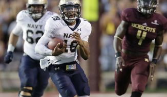 Navy 's Tago Smith (18) rushes against Texas State during the first half of an NCAA college football game, Saturday, Sept. 13, 2014, in San Marcos, Texas. (AP Photo/Eric Gay)