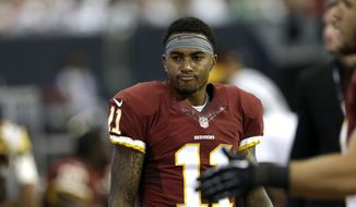 Washington Redskins wide receiver DeSean Jackson (11) shows is frustration on the sidelines during the fourth quarter of an NFL football game against the Houston Texans Sunday, Sept. 7, 2014, in Houston. (AP Photo/David J. Phillip)