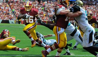 Washington Redskins running back Alfred Morris (46) rushes into the end zone behind the blocking of center Kory Lichtensteiger (78) for a second quarter touchdown against the Jacksonville Jaguars at FedEx Field, Sept. 14, 2014. (Preston Keres/Special for The Washington Times)
