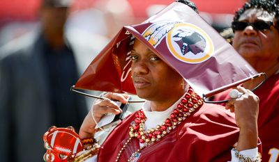 Washington Redskins quarterback Robert Griffin III's mother Jackie Griffin watches warmups before the Washington Redskins play the Jacksonville Jaguars at FedExField, Landover, Md., Monday, September 9, 2013. (Andrew Harnik/The Washington Times)