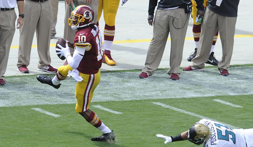 Washington Redskins quarterback Robert Griffin III (10) injures his left ankle as tries to avoid Jacksonville Jaguars middle linebacker Paul Posluszny (51) in the first quarter  at FedEx Field, Sept. 14, 2014. (Preston Keres/Special for The Washington Times)