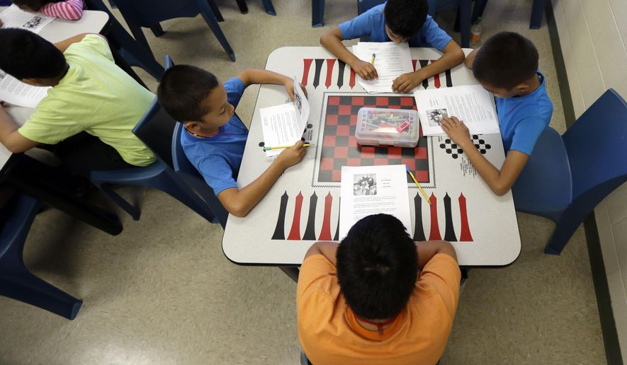 In this Wednesday, Sept. 10, 2014 photo, a short story in Spanish is used in a class at the Karnes County Residential Center, a temporary home for immigrant women and children detained at the border, in Karnes City, Texas. (AP Photo/Eric Gay)