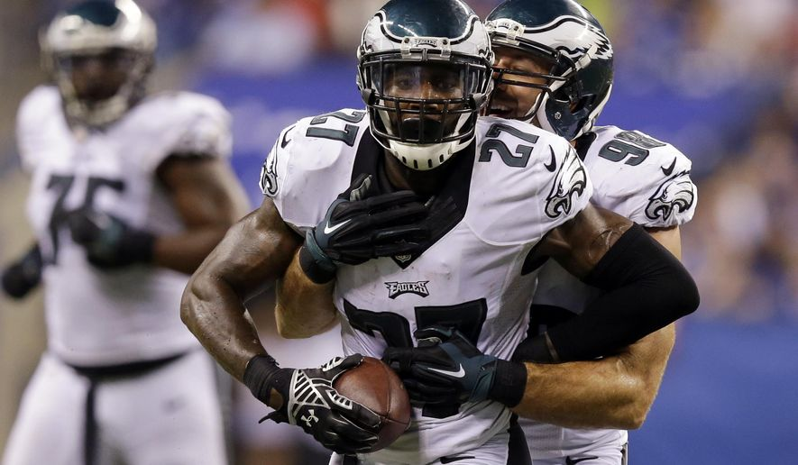 Philadelphia Eagles free safety Malcolm Jenkins (27) celebrates with Connor Barwin (98) after Jenkins made an interception during the second half of an NFL football game against the Indianapolis Colts Monday, Sept. 15, 2014, in Indianapolis. (AP Photo/Michael Conroy)
