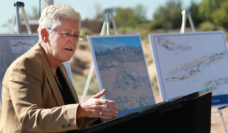 Environmental Protection Agency Administrator Gina McCarthy talks about the cooperation needed for building water infrastructure during the commemoration of a flood-control project in Corrales, N.M., on Monday, Sept. 15, 2014. McCarthy said the project is aimed at alleviating flooding concerns while keeping sediment from reaching the Rio Grande. (AP Photo/Susan Montoya Bryan)