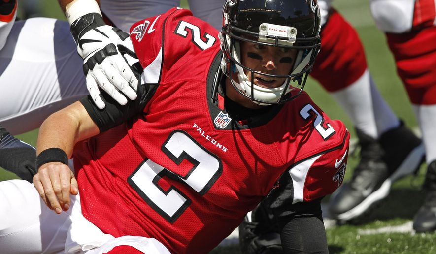 Atlanta Falcons quarterback Matt Ryan is helped up after being sacked in the second half of an NFL football game against the Cincinnati Bengals, Sunday, Sept. 14, 2014, in Cincinnati. (AP Photo/Frank Victores)