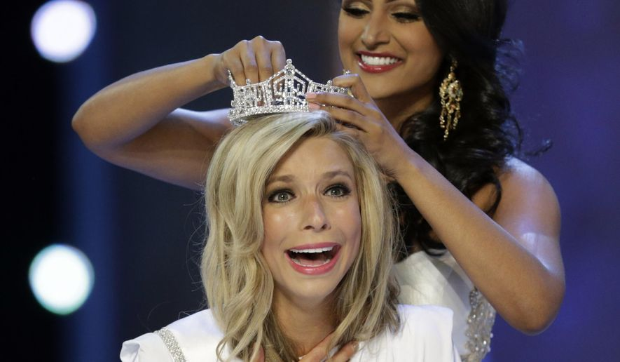 Miss America 2014 Nina Davuluri, top, crowns Miss New York Kira Kazantsev as Miss America 2015 during the Miss America 2015 pageant, Sunday, Sept. 14, 2014, in Atlantic City, New Jersey. (AP Photo/Julio Cortez)