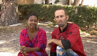 Actress Daniele Watts and Brian Lucas speak during an interview with KABC-TV in Los Angeles, Sunday, Sept. 14, 2014. The Los Angeles Police Department said officers detained Ms. Watts and her companion after a complaint that two people were involved in indecent exposure. Ms. Watts was detained until police determined no crime was committed. (AP Photo/KABC-TV)