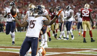 Chicago Bears wide receiver Brandon Marshall (15) celebrates after catching a 5-yard touchdown during the fourth quarter of an NFL football game against the San Francisco 49ers in Santa Clara, Calif., Sunday, Sept. 14, 2014. (AP Photo/Tony Avelar)