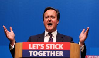 "Britain's Prime Minister David Cameron gestures, as he makes a speech in Aberdeen, Scotland, Monday Sept. 15, 2014. The Prime Minister issued a warning that Thursday's referendum is a ""once and for all"" decision as he made a last-ditch trip north to urge voters to save the union. (AP Photo/PA, Lynne Cameron) UNITED KINGDOM OUT NO SALES NO ARCHIVE"