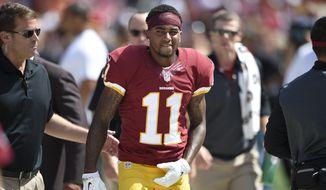 Washington Redskins wide receiver DeSean Jackson (11) walks after being injured during the first half of an NFL football game against the Jacksonville Jaguars, Sunday, Sept. 14, 2014, in Landover, Md. (AP Photo/Nick Wass)