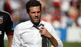 D.C. United head coach Ben Olsen, loosens his tie after an MLS soccer match against the New York Red Bulls, at RFK Stadium, Sunday, Aug. 31, 2014, in Washington. United won 2-0. (AP Photo/Alex Brandon) ** FILE **