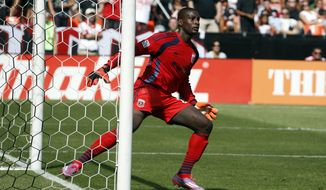 D.C. United goalkeeper Bill Hamid (28) in action during the first half of an MLS soccer match against the New York Red Bulls, at RFK Stadium, Sunday, Aug. 31, 2014, in Washington. (AP Photo/Alex Brandon)
