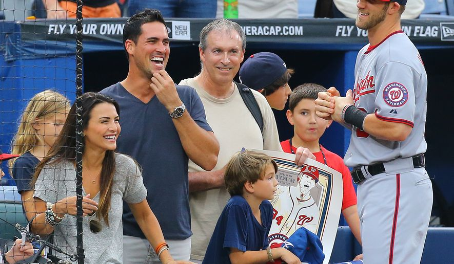 Former Bachelorette Andi Dorfman, left,  and Josh Murray , second from left, talk with  with Washington Nationals Bryce Harper before playing the Atlanta Braves in a baseball game on Monday, Sept. 15, 2014, in Atlanta.       (AP Photo/Atlanta Journal-Constitution, Curtis Compton)  MARIETTA DAILY OUT; GWINNETT DAILY POST OUT; LOCAL TELEVISION OUT; WXIA-TV OUT; WGCL-TV OUT