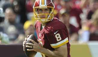 Washington Redskins quarterback Kirk Cousins (8) dros back for a pass against the Jacksonville Jaguars at FedEx Field, Sept. 14, 2014. (Preston Keres/Special for The Washington Times)