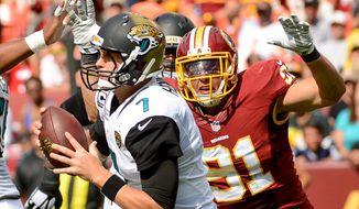 Washington Redskins defense swarms Jacksonville Jaguars quarterback Chad Henne (7) for a sack in the third quarter as the Washington Redskins play the Jacksonville Jaguars at FedExField, Landover, Md., Monday, September 9, 2013. (Andrew Harnik/The Washington Times)