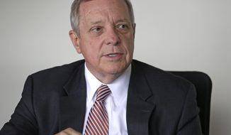 In this Sept. 12, 2014 photo, U.S. Sen. Dick Durbin D-Ill., answers questions during an interview with The Associated Press in Chicago. Durbin is running for re-election against Illinois State Sen. Jim Oberweis R-Sugar Grove, Ill., in the November general election. (AP Photo/M. Spencer Green)
