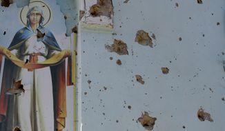 The village of Novosvitlivka in eastern Ukraine, where this Orthodox icon is located, which was severely damaged during fighting. (AP Photo/Darko Vojinovic)